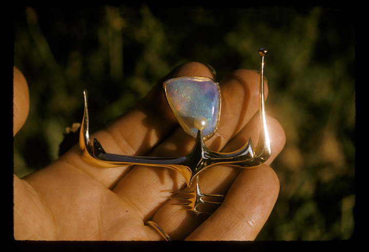 Ruth with pin, gold with opal, in Toza's hand, 1950s