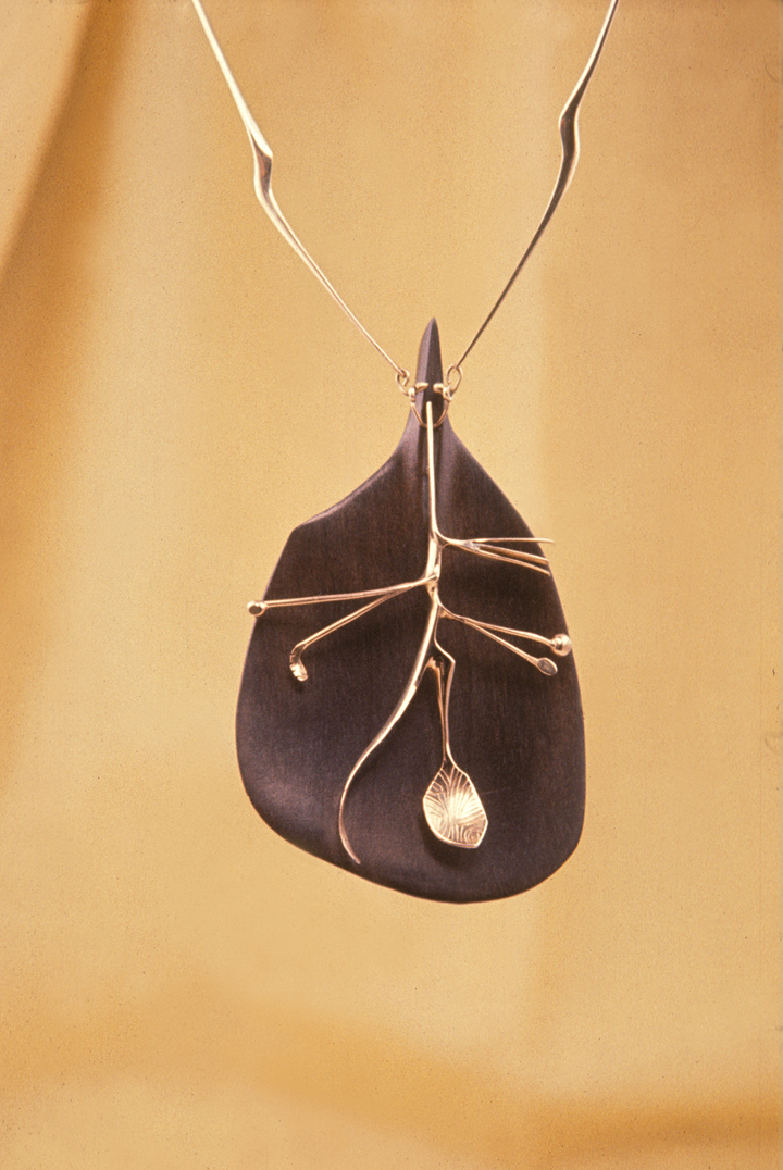 Toza, pendant, gold over ebony, 1960s